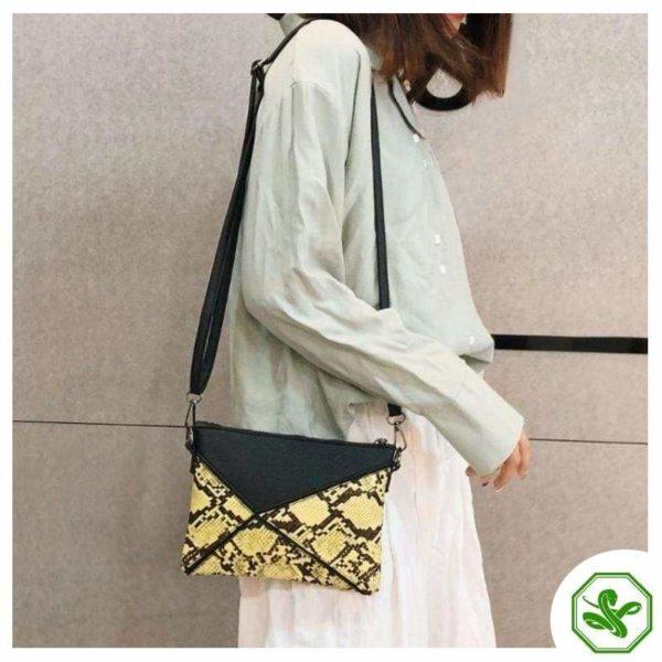 snakeskin clutch bag yellow