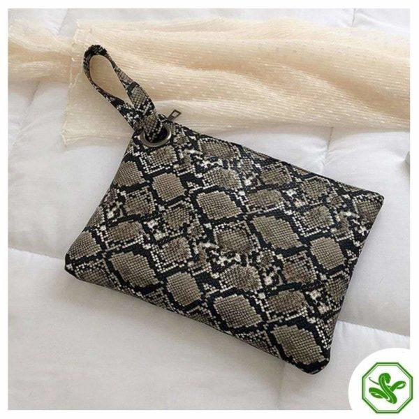 women's grey snake print clutch bag