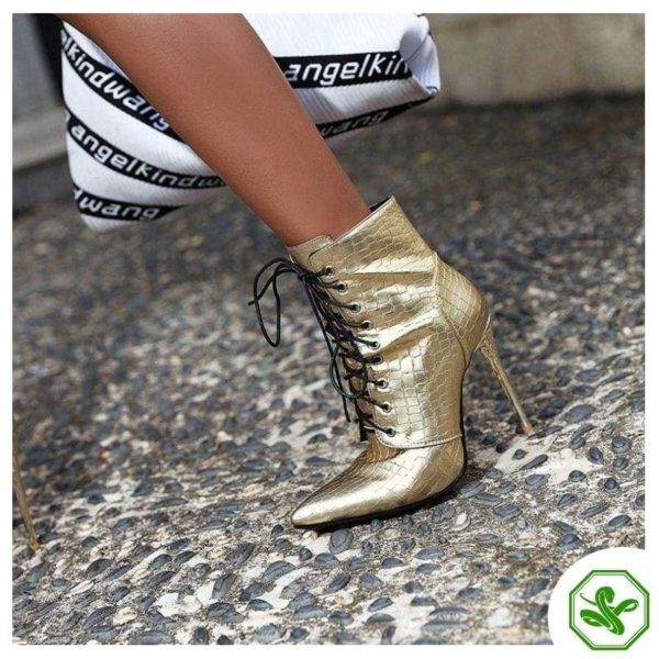 woman gold boot