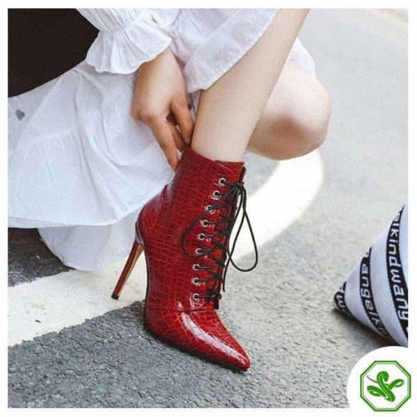 woman shiny red boots