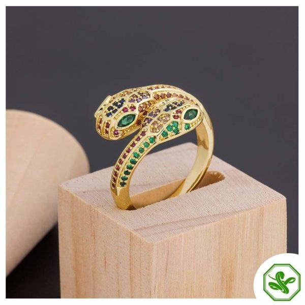 gols snake ring with emerald and red
