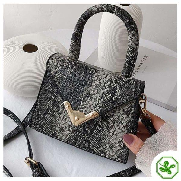 black python print handbag