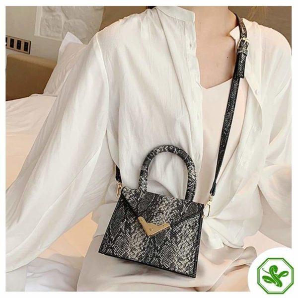 women's black python print handbag