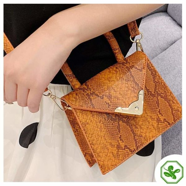 women orange python print handbag