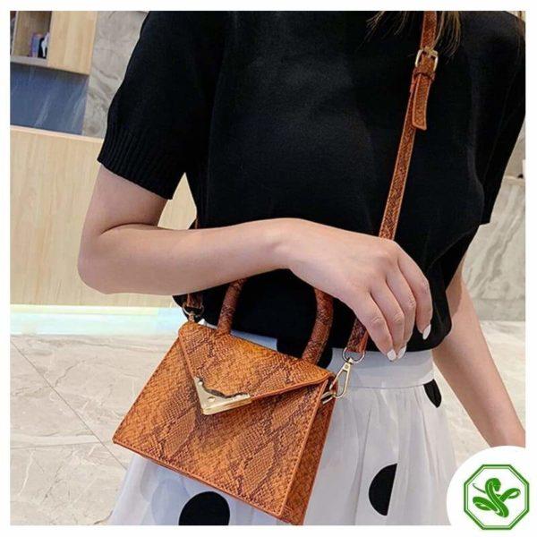 orange python print handbag for women