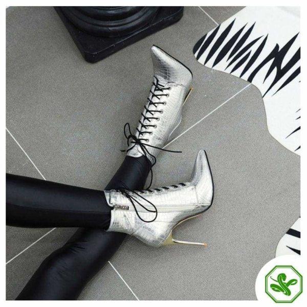 woman silver snake print boots