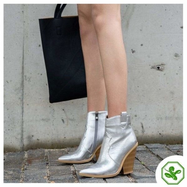 woman snake boots silver