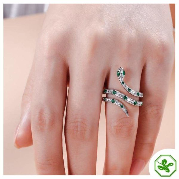 small snake ring with diamond and green