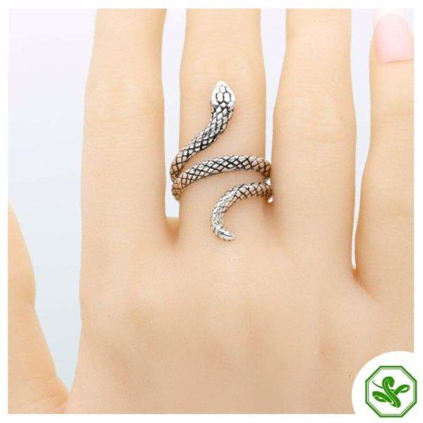 small snake ring on finger