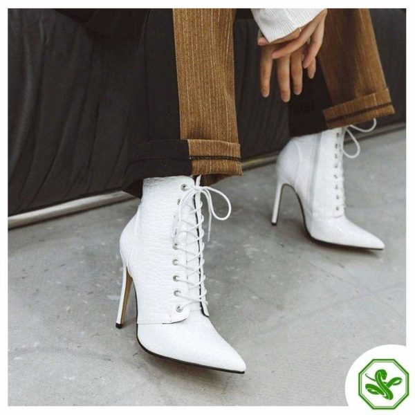 white heel snake boots woman