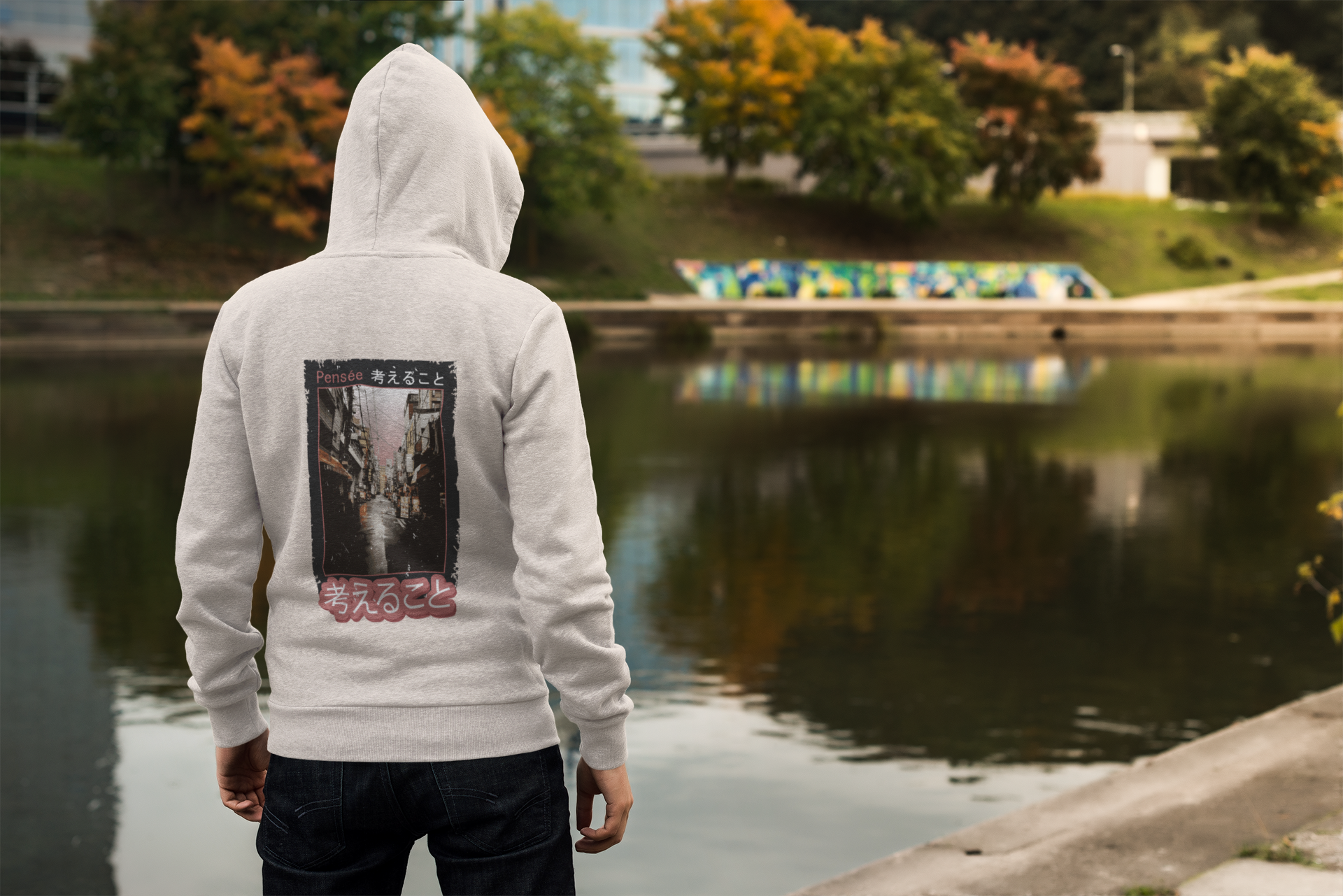 back view mockup of a man wearing a hoodie by a lake 3567 el1