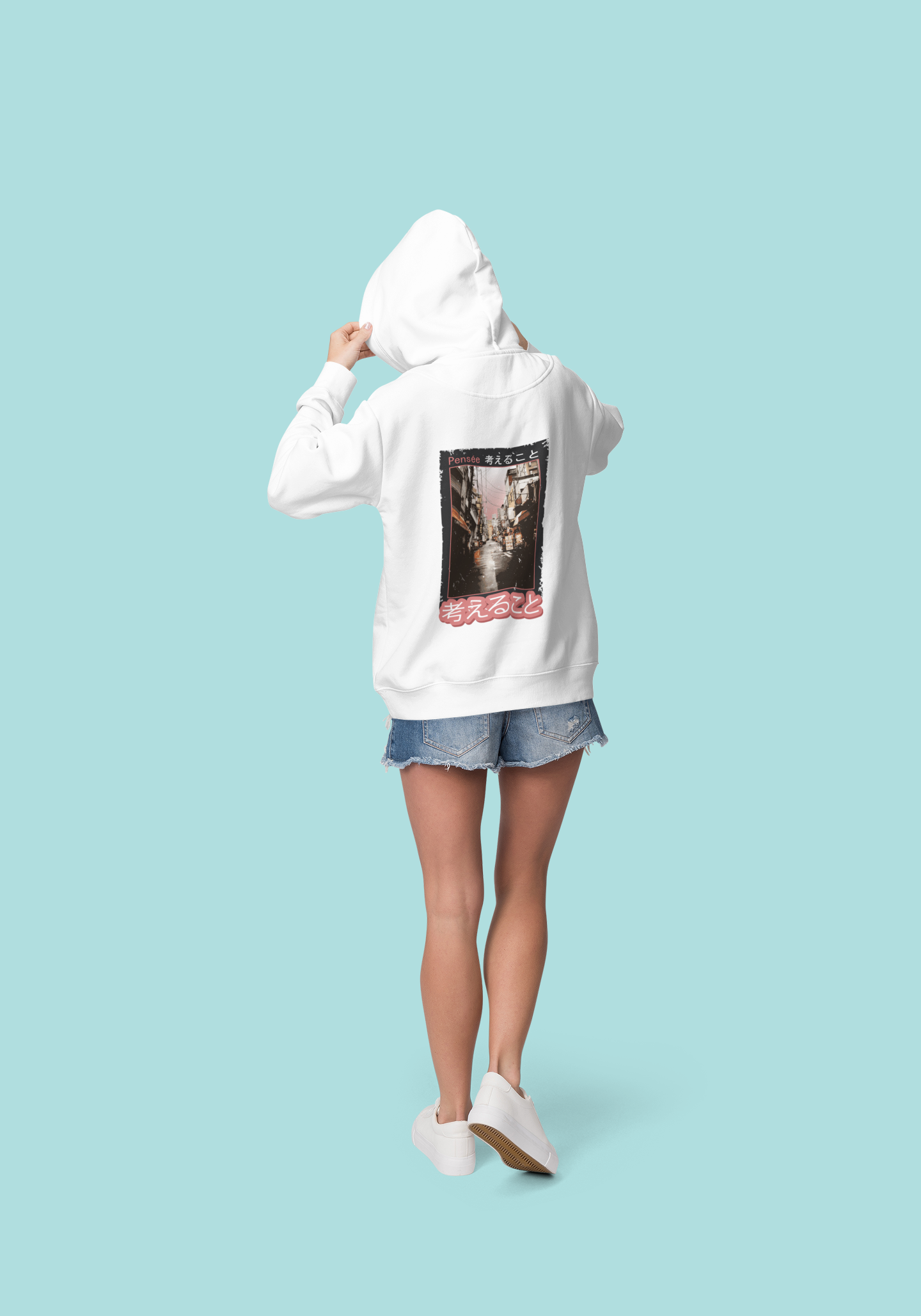 back view mockup of a woman wearing a hoodie at a studio 1797 el1