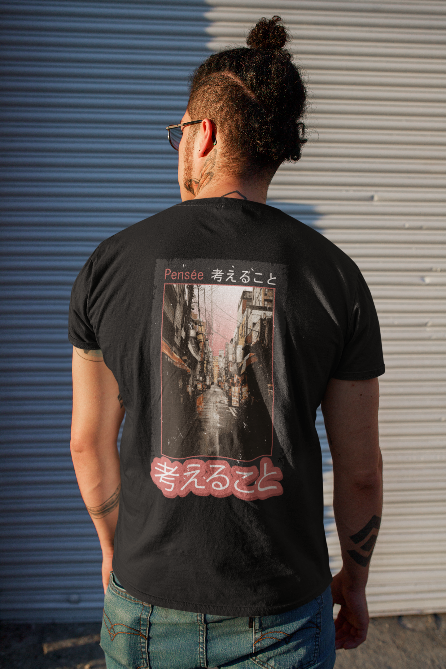 back view t shirt mockup featuring a man with a head bun standing on the street 32814