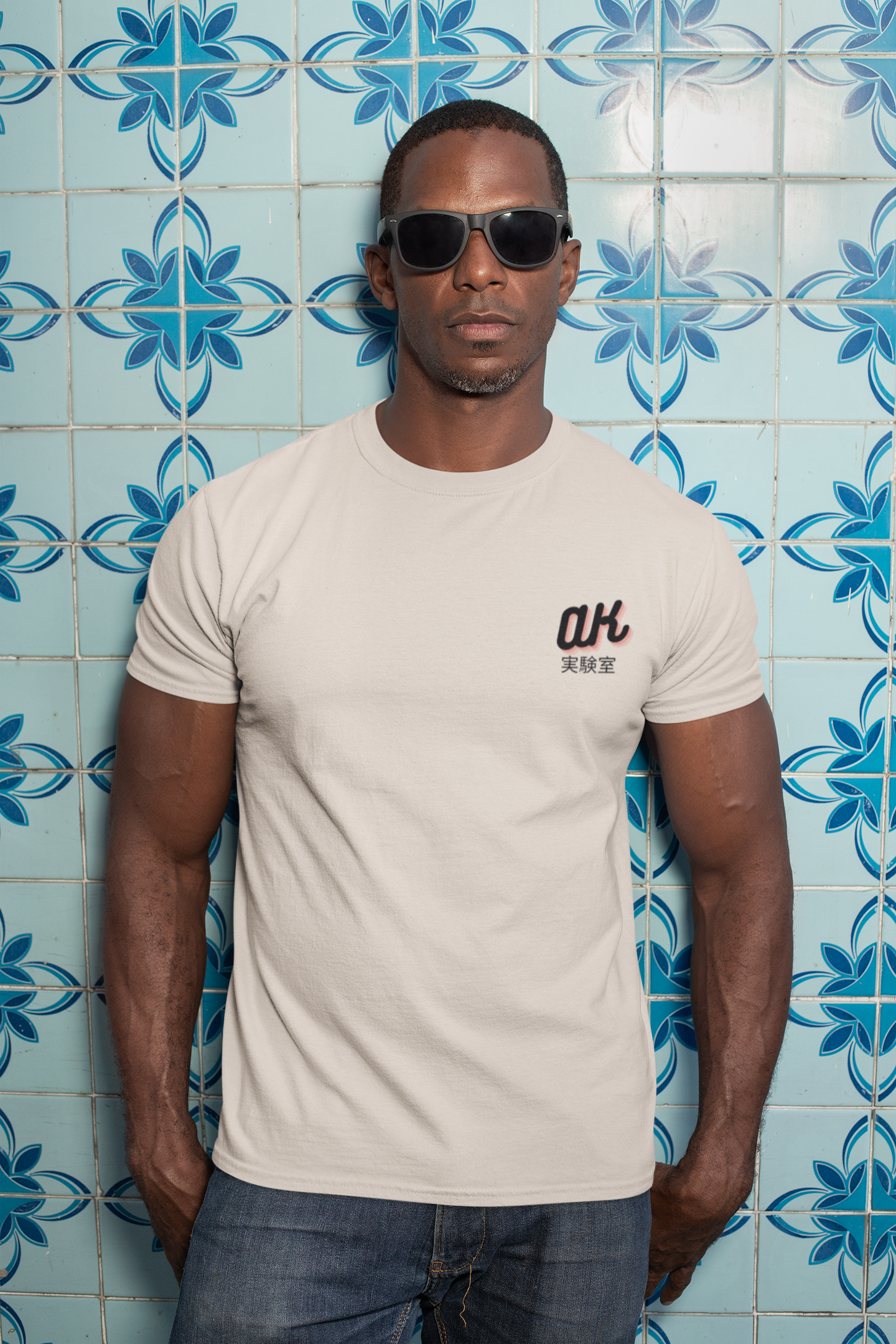 t shirt mockup of a man with sunglasses against a blue tiling 30449