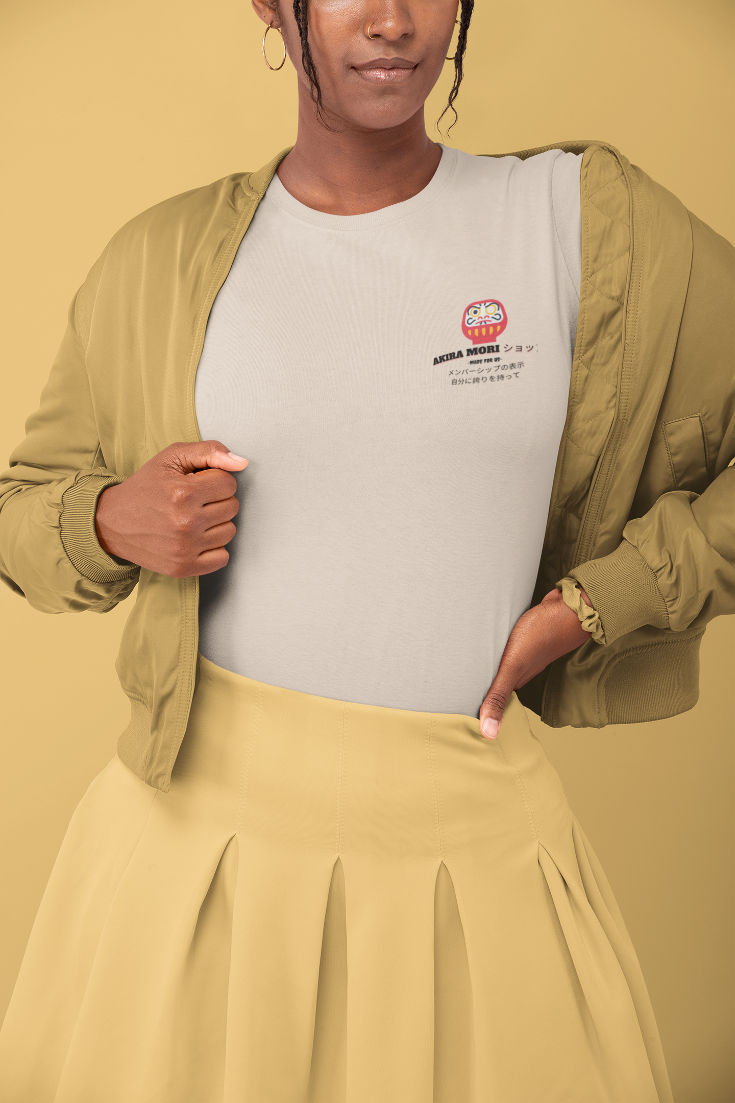 t shirt mockup of a woman in a monochromatic outfit posing at a studio 32795