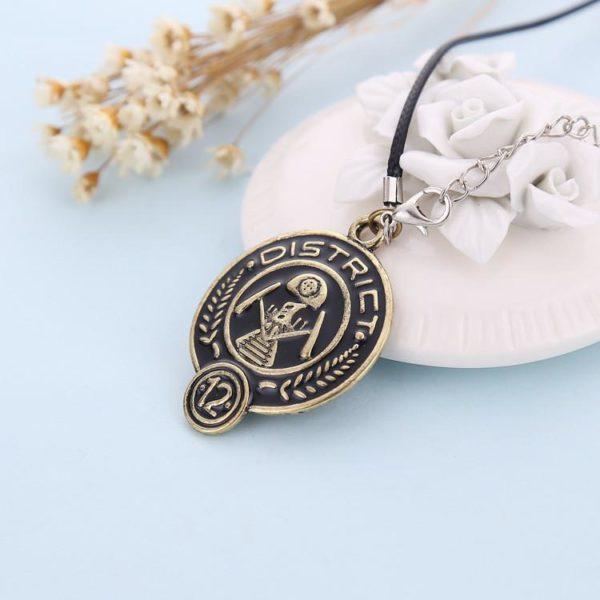 Collier District 12 Hunger Games - Livraison Gratuite !