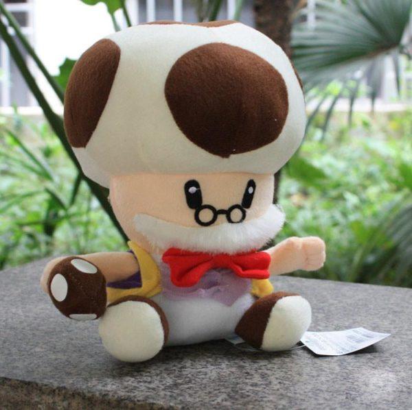 Super Mario Bros En Peluche Jouets Doux En Peluche Poup eacute bcab487a b7a2 4631 85e4 5de475b76f4d Peluche Papi Champi (25 Cm) Super Mario Bros - Livraison Gratuite !