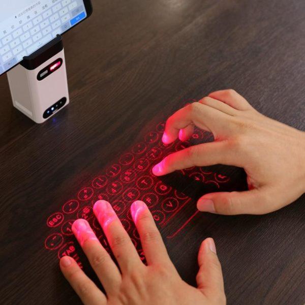 Mini clavier de Projection sans fil de clavier de laser virtuel de Bluetooth Portable pour l 7bdbb5fc 0c84 4f65 b9af 23d0f10b38bf Clavier De Projection Sans Fil De De Laser : Prend En Charge Usb Et Bluetooth