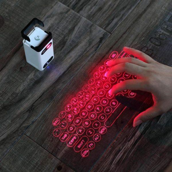 Mini clavier de Projection sans fil de clavier de laser virtuel de Bluetooth Portable pour l a63bfd58 e443 4bca 90ed e5117a7f168e Clavier De Projection Sans Fil De De Laser : Prend En Charge Usb Et Bluetooth